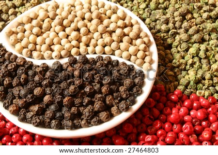 Closeup of pepper grains in four different colors