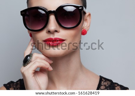 Closeup of perfect model in big rounded sunglasses. text space and copy space