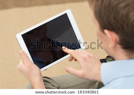 Closeup Of Person Holding Digital Tablet With Blank Screen - stock photo