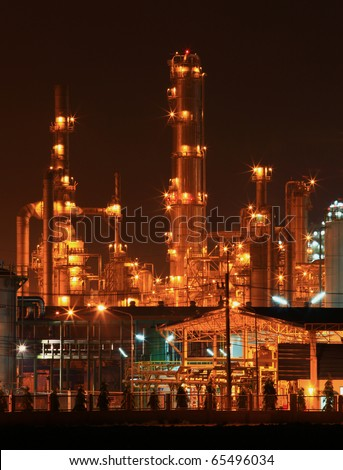 closeup of petrochemical oil refinery factory pipeline at night - stock photo