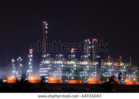 closeup of petrochemical oil refinery plant at night