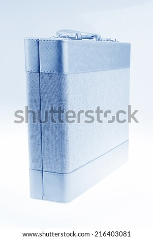closeup of photo, suitcase on a pure color background