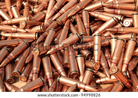 closeup of pictures, piles of rifle bullets - stock photo
