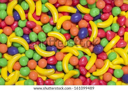 Closeup of pile of colorful hard fruit shaped candy - stock photo