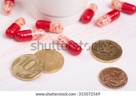 closeup of Pills and money. Health care concept