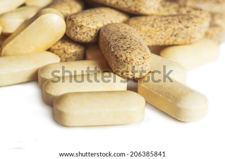 Closeup of pills isolated on white background. Shallow depth of field. - stock photo