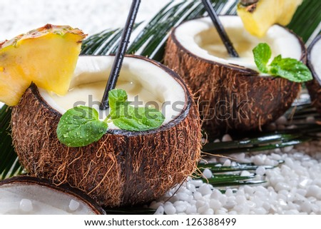Closeup of pinacolada drink in the fresh coconut - stock photo