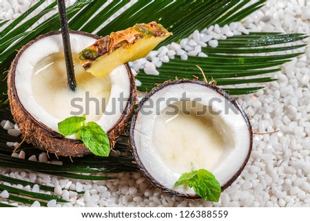 Closeup of pinacolada drink served in a coconut - stock photo