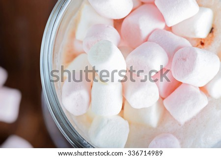 Closeup of pink and white  marshmallows in hot chocolate in the glass - stock photo