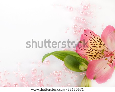 Closeup of pink beads with flower on a white background - stock photo