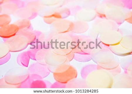 Closeup of pink confetti texture. Shallow DOF.