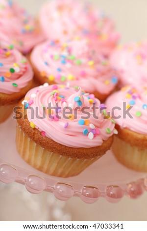 Closeup of pink cupcakes on pedestal - stock photo