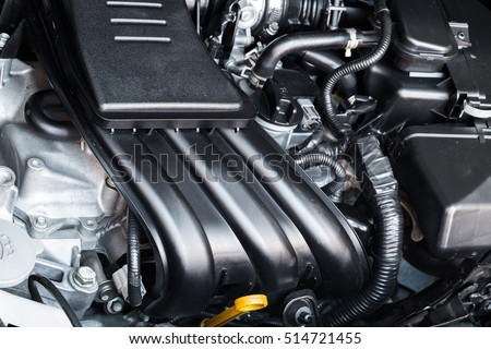 Closeup of 3 piston engine in car. Engine power saving. Engine in city car.