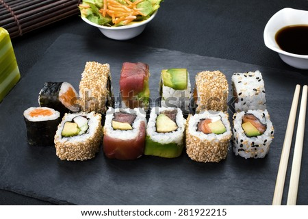 closeup of platter with sushi menu assorted on the table restaurant / sushi rolls - stock photo