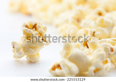 Closeup of popcorn on white background - stock photo