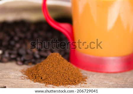 closeup of powder coffee with a coffee cup and beans on the background selective focus - stock photo