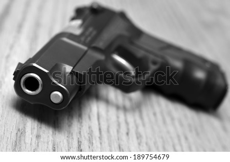 Closeup of powerful handgun on old wooden surface - stock photo