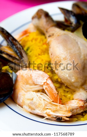closeup of prawn with rice - traditionnal spanish food paella