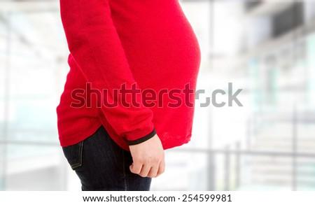 Closeup of pregnant woman - stock photo