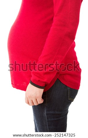 Closeup of pregnant woman at white background - stock photo