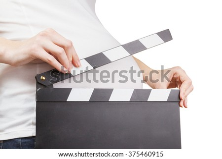 Closeup of pregnant woman holding clapperboard isolated on white background. Pregnancy concept - stock photo