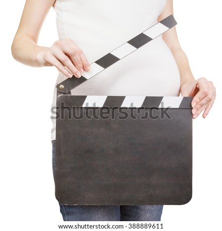 Closeup of pregnant woman holding clapperboard with copyspace isolated on white background   - stock photo