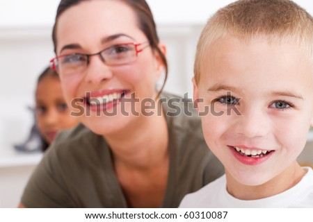 closeup of preschool boy and teacher - stock photo