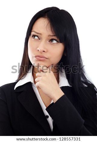 Closeup of pretty businesswoman with her hand at her chin, looking at the copyspace. Isolated on white background - stock photo
