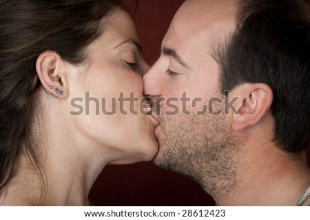 Closeup of pretty woman and handsome man kissing - stock photo