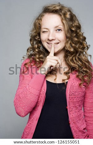 Closeup of pretty woman making silent gesture - stock photo