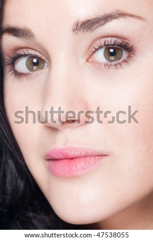 closeup of pretty young adult looking at camera - stock photo