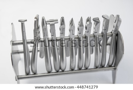 Closeup of professional dental tools on white background