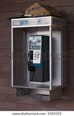 Closeup of public coin-operated telephone - stock photo