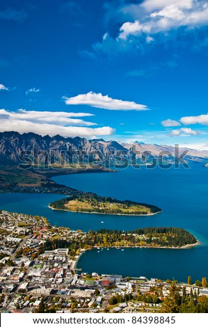 closeup of queenstown with lake Wakatipu from top at noon. - stock photo