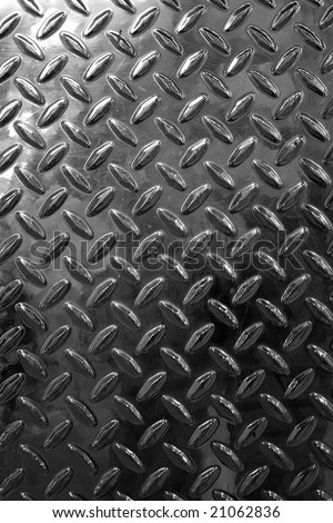 Closeup of real diamond plate material - this is a photo not an illustration. - stock photo