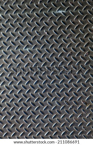 Closeup of real diamond plate metal material. This is the real thing and not an illustration. - stock photo