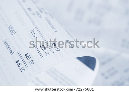 Closeup of receipts, shallow focus - stock photo