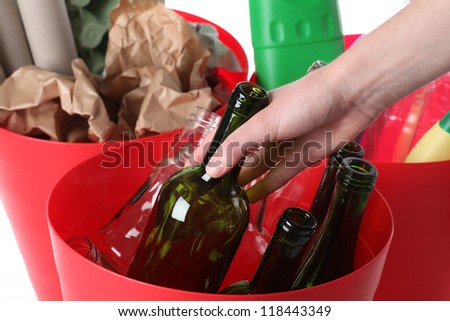 Closeup of recycle bins, putting glass bottle - stock photo