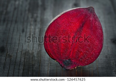 Closeup of red beet on dark wooden background - stock photo