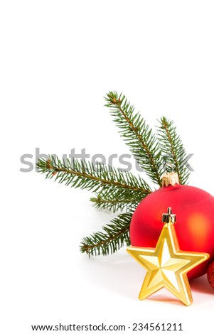 Closeup of red Christmas balls and fir branch on white background.