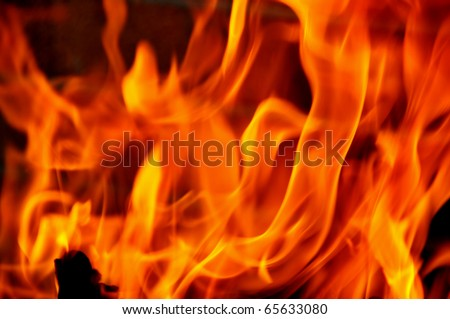 closeup of red fire flames of a fireplace - stock photo