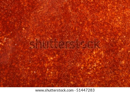 Closeup of red glaze background with bubbles - stock photo