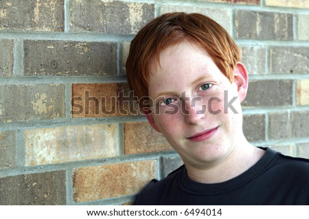 closeup of red haired freckles teen boy