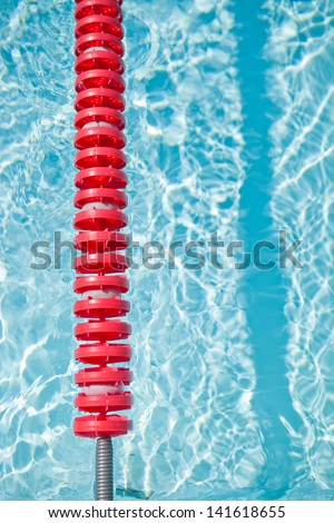 Closeup of red lane rope in swimming pool - stock photo
