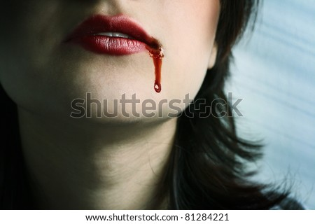 Closeup of Red lips of a young girl, with blood flowing by. - stock photo