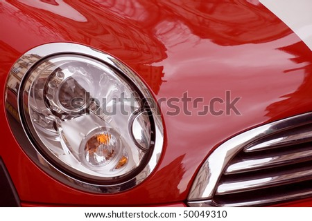 closeup of red luxury sports car - stock photo