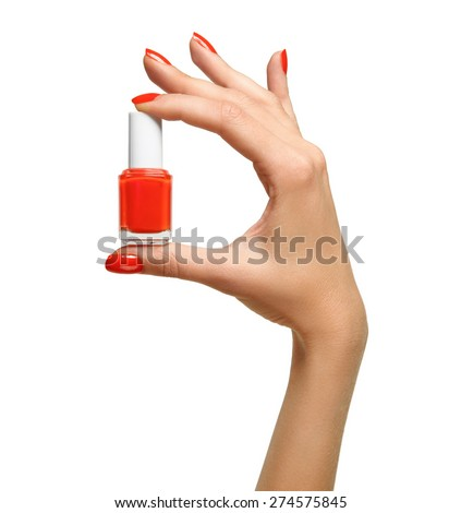 closeup of red nail polish in the hand of - stock photo