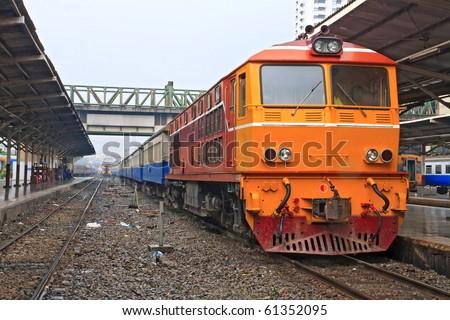 Closeup of Red orange train, Diesel locomotive, on Bangkok railway station platform Thailand - stock photo