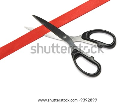 Closeup of red ribbon with scissors. Isolated on white background with light shadow - stock photo