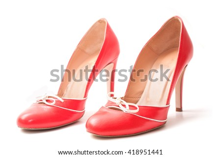 closeup of  red stilettos shoes on white background